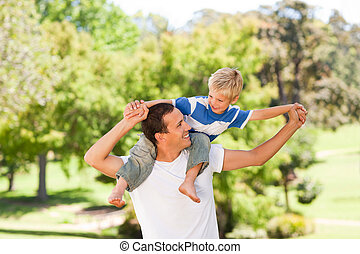 Man giving son a piggyback