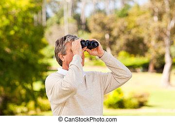 Mature man birds watching