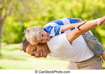 Son playing with his father in the park