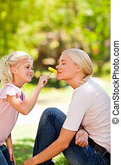 Mother and her daughter smelling a