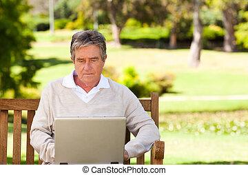 Senior man working on his laptop