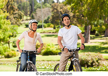 Couple with their bikes in the park