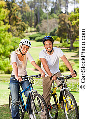 Couple in the park with their bikes