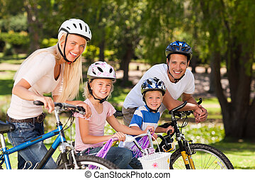 Family in the park with their bikes