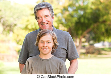 Grandfather with his grandson in the park
