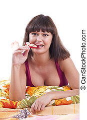 Young woman with candy on pillow