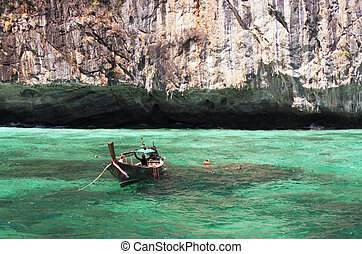 longtail boat in turquoise waters, phi-phi island, phuket,...