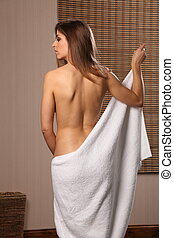 Beautiful woman naked back   towel