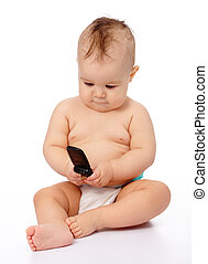 Cute little baby plays with mobile phone, isolated over...