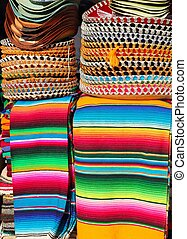 Mexican serape colorful stacked and charro hats mariachi