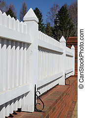 Picket Fence - White picket fence with brick foundation