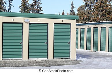 Stuff you don't need: storage units with a blue sky and...