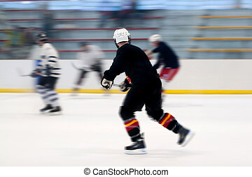 Hockey Players On the Ice - Panned motion blur of two hockey...