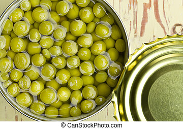 canned green peas in open tin can