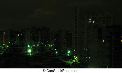 Residental houses an night, time lapse - Lights at block of...
