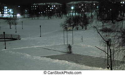man removing snow from the ice rink time lapse