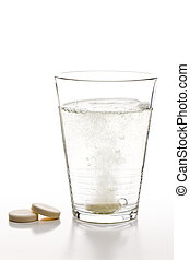 effervescent tablets and glass with water - the effervescent...