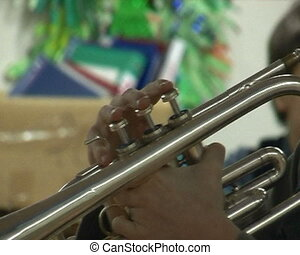 Man playing the trumpet hand close up