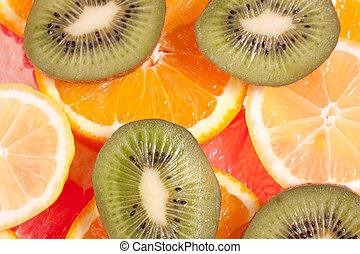 assorted fruits of apple, grapefruit, orange, lemon and kiwi...