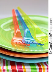 colorful plastic tableware  and napkins for picnics