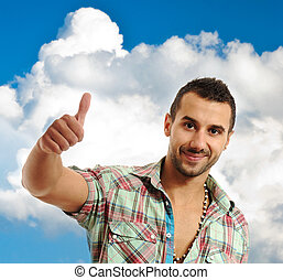 Happy casual young man showing thumb up and smiling isolated on white background