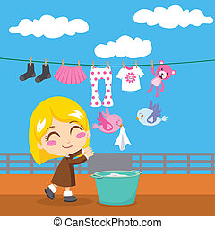 Sweet Laundry - Cute blond little girl doing laundry with...