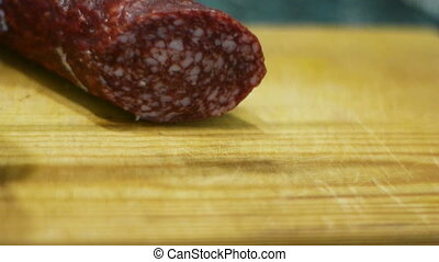 Cutting salami to slices HD video
