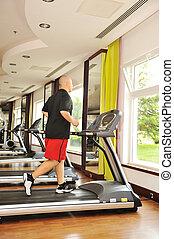 Man jogging indoor, running