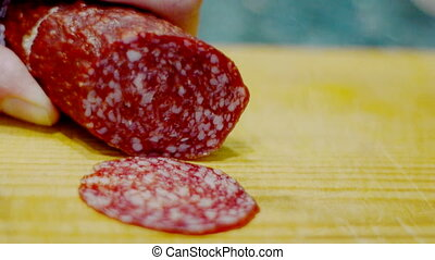 Cutting sausage to slices - Cutting salami to slices on...