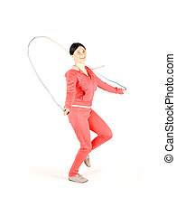 Fitnes, girl jumping over rope