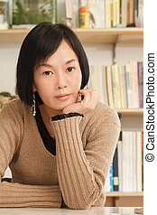 Asian mature woman - Portrait of Asian mature woman looking...