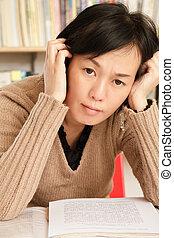 Worried mature Asian woman