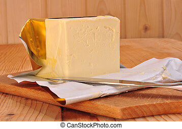 a cube margarine and a kitchen knife