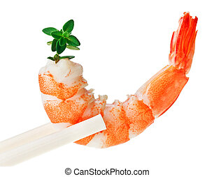 Cooked tiger shrimp with thyme twig in chopsticks