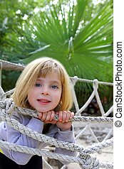adventure little girl on jungle park rope bridge - adventure...