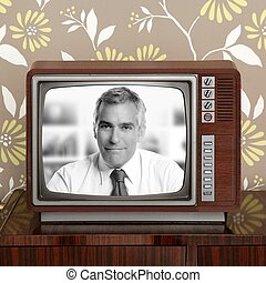 senoir tv presenter in retro wood television