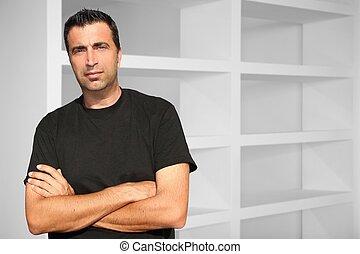 Medium age man interior house white shelves modern designer