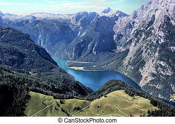 The Lake Koenigssee is surround of the Berchtesgaden Alps in...
