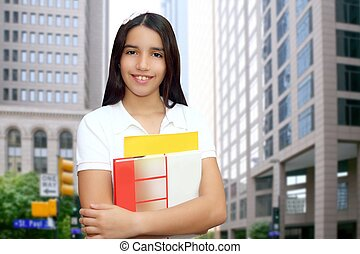 Brunette student young girl teen latin holding books modern...