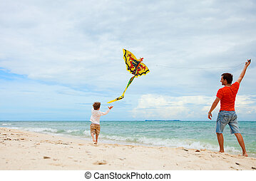 Father and son flying kite - Young father and his son...
