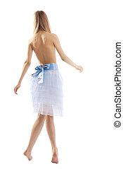 Beauty blond girl walk in light
