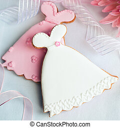 Wedding dress cookies in pink and white