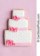 Wedding cake cookie decorated with pink and white frosting