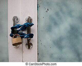 Door with chain and padlock
