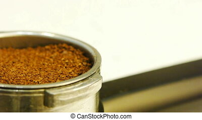 Filling up coffee machine with coffee powder