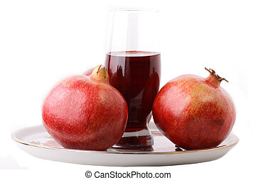 A glass of pomegranate juice isolated on the white background