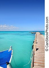 boat in wood pier Cancun tropical Caribbean sea