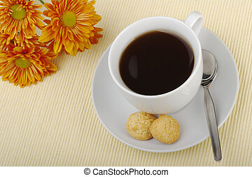 Black Tea - Blacktea in cup with saucer, teaspoon, biscuits...