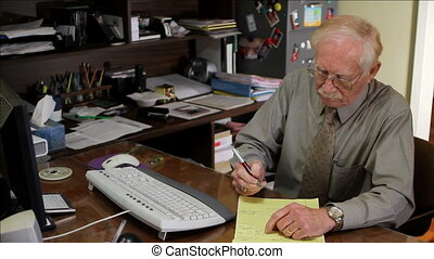 Working Retirement - Elderly man works his business in his...