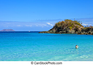 trunk bay and snorkeler